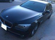 Lên đời cần bán rẻ xe BMW 750li nhập Mỹ, đời 2011 màu đen nhám full option giá 1 tỷ 350 tr tại Tp.HCM