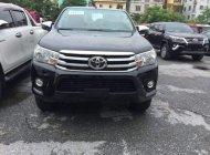 Toyota Thăng Long bán Toyota Hilux 2.4G 2 cầu máy dầu, số sàn 6 cấp, mới 100%, mau đen, giao ngay giá 793 triệu tại Hà Nội