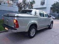 Bán lại xe Toyota Hilux màu bạc, máy dầu, số sàn, 1 cầu, sản xuất 2014 giá 490 triệu tại Tp.HCM