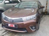 Bán ô tô Toyota Corolla altis 2014, màu nâu, số sàn, 620 triệu giá 620 triệu tại Tp.HCM