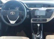 Bán Toyota Vios 1.5E sản xuất 2018, màu trắng  giá 569 triệu tại Hà Nội