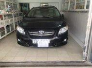 Cần bán lại xe Toyota Corolla altis sản xuất năm 2010, màu đen giá 550 triệu tại Tp.HCM