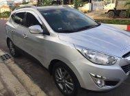 Bán Hyundai Tucson 2.0 AT 4WD đời 2011, màu bạc, nhập khẩu, số tự động giá 560 triệu tại Gia Lai