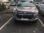 Bán xe Toyota Innova E sản xuất năm 2018, màu đồng ánh kim giá 750 triệu tại Tp.HCM