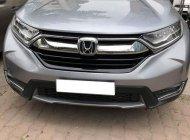 Gia đình cần bán Honda CRV, sx 5/2018, dòng xe 7 chỗ, màu bạc giá 1 tỷ 218 tr tại Tp.HCM