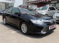 270 triệu có ngay Toyota Camry 2.0E năm 2015, màu đen  giá 875 triệu tại Hà Nội