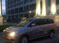 Bán xe Toyota Innova E năm sản xuất 2014, màu vàng, số sàn giá 560 triệu tại Hà Nội