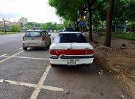 Bán Mazda 323 1.6 MT đời 1995, màu trắng, xe nhập giá 75 triệu tại Hà Nội