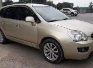Cần bán Kia Carens đời 2011 - bản đủ - máy 2.0 - cửa nóc – màu vàng cát giá 295 triệu tại Hà Nội