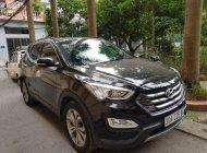 Bán xe Hyundai Santa Fe 2.4 4WD sản xuất năm 2014, màu đen, nhập khẩu nguyên chiếc giá 910 triệu tại Hà Nội