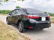 Cần bán xe Toyota Corolla altis 1.8G AT 2018, màu đen chính chủ giá cạnh tranh giá 789 triệu tại Hà Nội