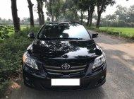 Cần bán gấp Toyota Altis 2009 số sàn, màu đen giá 412 triệu tại Tp.HCM