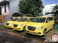 Cần bán lại xe Toyota Innova E đời 2014, màu vàng còn mới giá Giá thỏa thuận tại Đà Nẵng