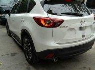 Gia đình cần bán lại xe Mazda CX5 màu trắng Camay, mua hãng cuối 12/2016, hàng full thắng điện giá 795 triệu tại Tp.HCM