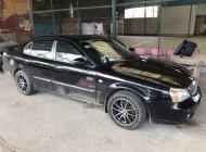 Cần bán gấp Daewoo Magnus 2.5L 2004, màu đen số tự động, giá tốt giá 130 triệu tại An Giang