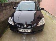 Cần bán gấp Mitsubishi Lancer năm 2003, màu đen, nhập khẩu nguyên chiếc, 190tr giá 190 triệu tại Nghệ An