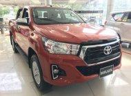 Bán xe Toyota Hilux 2.4E năm sản xuất 2018, màu đỏ, nhập khẩu giá 695 triệu tại Tp.HCM