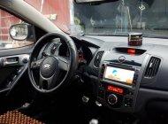 Cần bán gấp Kia Forte EX 1.6 MT 2010, màu đen số sàn giá 299 triệu tại Hà Nội