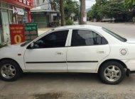 Cần bán xe Mazda 323 sản xuất 2000, màu trắng giá 89 triệu tại Cao Bằng