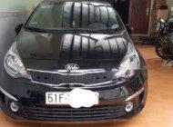 Cần bán xe Kia Rio AT sản xuất 2015, màu đen giá 495 triệu tại Tp.HCM