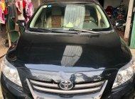 Bán xe Toyota Corolla Altis 1.8G sx 2009, số tay, máy xăng, màu đen, nội thất màu kem, đã đi 154000 km giá 390 triệu tại Ninh Bình