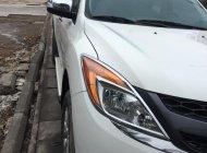 Cần bán xe Mazda BT50 đời 2014 máy dầu, số tự động, màu trắng, 2 cầu bản full giá 567 triệu tại Tp.HCM