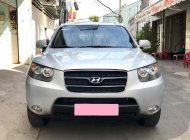 Bán xe Hyundai Santafe 2009 số sàn màu bạc, gia đình chính chủ giá 393 triệu tại Tp.HCM