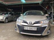 Bán xe Toyota Vios 1.5AT sản xuất năm 2018, màu vàng số tự động giá 552 triệu tại Tp.HCM