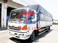 Bán xe tải Hino FC EURO4 mui bạt 6 tấn, thùng dài 7 mét kèm ưu đãi giá 1 tỷ 14 tr tại Tp.HCM