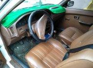 Bán Toyota Corolla 1990, màu trắng xe gia đình, giá 69tr giá 69 triệu tại Cần Thơ