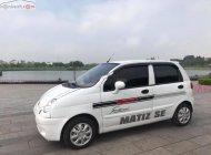 Cần bán lại xe Daewoo Matiz SE năm sản xuất 2005, màu trắng giá 58 triệu tại Hà Nội