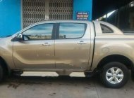 Bán Mazda BT-50 2.2L 4x4MT năm sản xuất 06/2014, xe nhập khẩu Thái Lan, màu vàng cát, 2 cầu giá 475 triệu tại An Giang