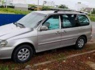 Chính chủ bán lại xe Kia Carnival V6 2.5 năm 2009, màu bạc giá 295 triệu tại Tp.HCM