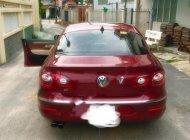 Cần bán xe Volkswagen Passat năm sản xuất 2011, màu đỏ, đăng ký tháng 1/2013 giá 565 triệu tại Bình Dương