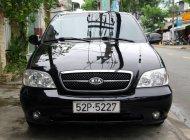 Cần bán Kia Carnival GS sản xuất 2008, màu đen giá 245 triệu tại Tp.HCM