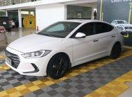 Bán ô tô Hyundai Elantra GLS 1.6AT đời 2016, màu trắng giá 566 triệu tại Tp.HCM