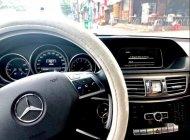 Bán Mercedes E200 đời 2014, màu trắng chính chủ giá 1 tỷ 220 tr tại Tp.HCM