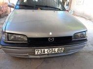 Cần bán xe Mazda 323 1.6MT đời 1995, màu bạc, nội thất đẹp chính chủ giá 45 triệu tại Quảng Bình