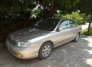 Bán xe Kia Spectra năm sản xuất 2005, màu vàng cát giá 93 triệu tại Ninh Bình