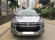 Gia đình cần bán xe Toyota Innova 2.0E, model 2018, màu bạc giá 675 triệu tại Tp.HCM