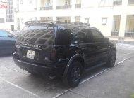Cần bán lại xe Ford Escape 2.0L 4x4 MT sản xuất 2003, màu đen giá 195 triệu tại Hà Nội