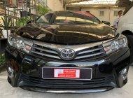 Bán ô tô Toyota Corolla altis V đời 2014, màu đen, số tự động giá 690 triệu tại Tp.HCM