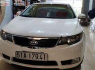 Cần bán Kia Forte đời 2011, màu trắng, số sàn  giá 344 triệu tại Tp.HCM
