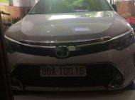 Cần bán xe Toyota Camry 2.0E đời 2019, màu trắng giá 975 triệu tại Bình Thuận