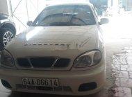 Cần bán gấp Daewoo Lanos năm 2003, màu trắng, nhập khẩu nguyên chiếc, giá 830tr giá 830 triệu tại Vĩnh Long