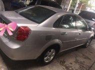 Bán xe Daewoo Lacetti 2011, màu nâu chính chủ, còn nguyên bản giá 220 triệu tại Bình Phước