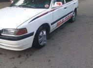 Bán xe Mazda 323 năm sản xuất 1997, màu trắng, xe nhập khẩu chính hãng giá 34 triệu tại Thanh Hóa