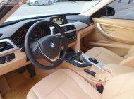 Cần bán gấp BMW 3 Series 2015, màu trắng, nhập khẩu   giá 1 tỷ tại Tp.HCM