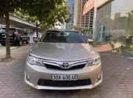 Bán Toyota Camry XLE 2.5 đời 2014, màu vàng, nhập khẩu chính hãng giá 1 tỷ 150 tr tại Hà Nội