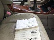 Bán xe Toyota Camry đời 2004, màu đen chính chủ giá 394 triệu tại Tp.HCM